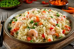 Shrimp Rice Pilaf. Delicious shrimp and vegatable rice pilaf with green peas, carrots and red peppers stock images