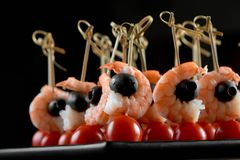 Delicious shrimps appetizer on the dark background. Stock Image