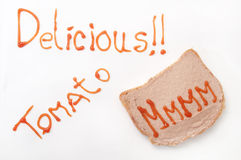 Delicious sign with ketchup and mmmm on the bread with pate Royalty Free Stock Images