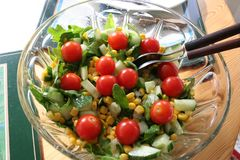 Salad with tomato, cucumber, maize ruccula salad and so on stock image