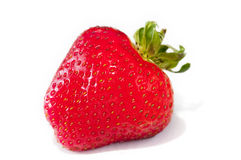 Delicious single strawberry on white. Delicious single fresh strawberry on white Stock Photography