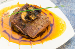 Delicious sirloin steak placed upon a bed of curry Royalty Free Stock Photography