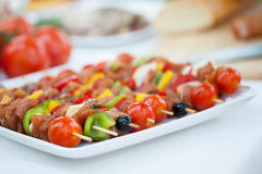 Delicious skewers on barbecue stock photos