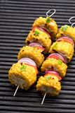 Delicious skewers with grilled corn and pepper on grill royalty free stock image