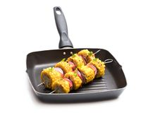 Delicious skewers with grilled corn and pepper on grill pan isolated on white royalty free stock photo