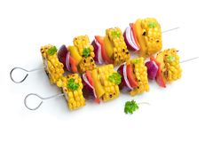 Delicious skewers with grilled corn and pepper isolated on white royalty free stock photos