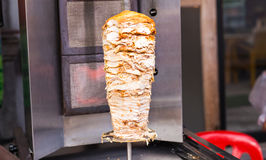 Delicious slabs of skewered fast food shawerma chicken and lamb meat on a spit. Stock Images