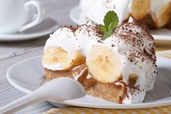 Delicious slice of banana cake Banoffee close-up horizontal Royalty Free Stock Image