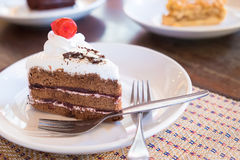 Delicious slice of Black Forrest Cake. On a plate and ready to e Stock Images