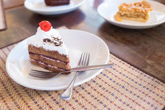 Delicious slice of Black Forrest Cake. On a plate and ready to e Stock Photo