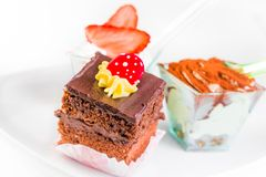 Delicious slice of chocolate cake with cream and candy to sugar Royalty Free Stock Image