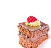 Delicious slice of chocolate cake with cream and sugar candy on top Stock Photos