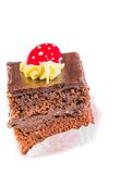 Delicious slice of chocolate cake with cream and sugar candy on top Royalty Free Stock Photos