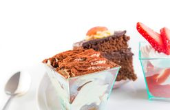 Delicious slice of chocolate cake named tiramisu on white Stock Photos