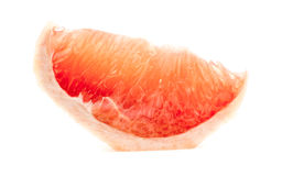 Delicious slice of grapefruit isolated on white Royalty Free Stock Image