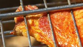 Delicious slice of juicy pork steaks over coals stock video