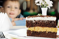 Delicious slice of layered birthday cake Stock Photo