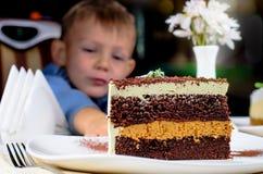Delicious slice of layered birthday cake Stock Photos