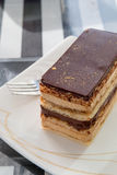 Delicious slice of opera cake on a plate Royalty Free Stock Photography