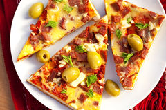 Delicious slice of pizza Stock Images