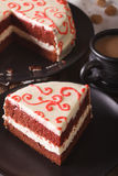 Delicious slice of red velvet cake on a plate closeup. vertical Royalty Free Stock Photos