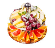 Delicious sliced fruits as a dessert platter. Stock Photo