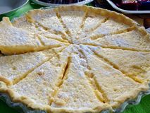 Delicious sliced homemade lemon curd pie tart for party Stock Photos
