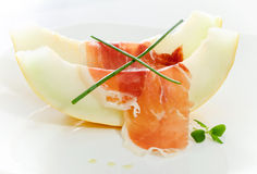 Delicious sliced melon and bacon Royalty Free Stock Photography