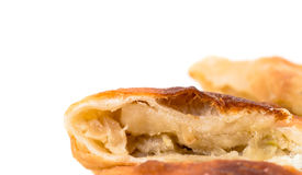 Delicious sliced puff pie with cabbage closeup. Royalty Free Stock Photography