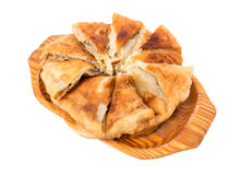 Delicious sliced puff pie with cabbage. Royalty Free Stock Photos
