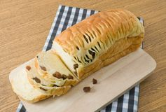 Delicious Sliced Raisin Bread on Wooden Cutting Board Royalty Free Stock Photography