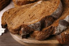 Delicious sliced rye bread on cutting board. Closeup Stock Photography