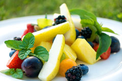 Delicious sliced summer fruit royalty free stock photography