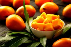 Delicious sliced sweet mangoes with leaves. Royalty Free Stock Images