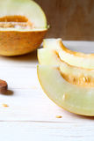 Delicious slices of melon on a white wooden table Royalty Free Stock Images