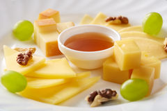 Delicious slicing from several varieties of cheese Stock Image