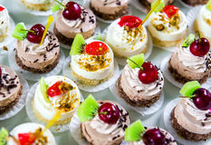 Delicious small fancy cakes Royalty Free Stock Photos