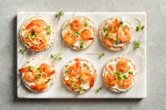 Delicious small sandwiches with shrimps. On marble board Stock Image