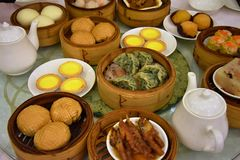 Delicious small snacks served from steamers prepare in Guangdong province. Dim sum is a style of Chinese cuisine particularly Cantonese prepared as small bite stock photos