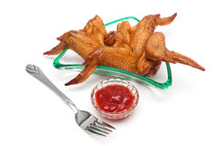 Delicious smoked chicken wings and ketchup on a white background Royalty Free Stock Photos