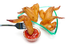 Delicious smoked chicken wings and tomato ketchup Stock Images