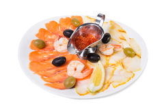 Delicious smoked fish platter with lemon. Stock Photography