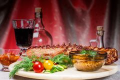 Smoked ribs with spices and vegetables royalty free stock photos
