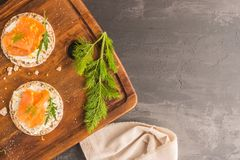 Smoked salmon on rice bread toasts Stock Photo
