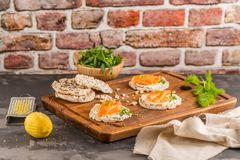 Smoked salmon on rice bread toasts Royalty Free Stock Photography