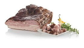 Delicious smoked slab bacon with portion diced on plate. Isolate stock photography