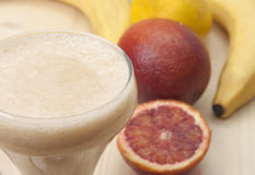 Delicious smoothie of banana. Delicious smoothie of banana, orange and lemon Stock Photography