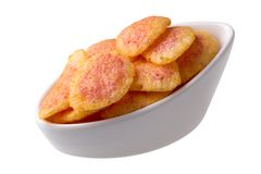Delicious snack chips isolated. Delicious snack chips in bowl isolated on white Royalty Free Stock Images