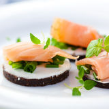 Delicious snack with smoked salmon Stock Images