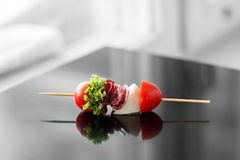 Delicious snacks with cherry, meat and mozzarella. Concept for food, catering, restaurant, party stock photography